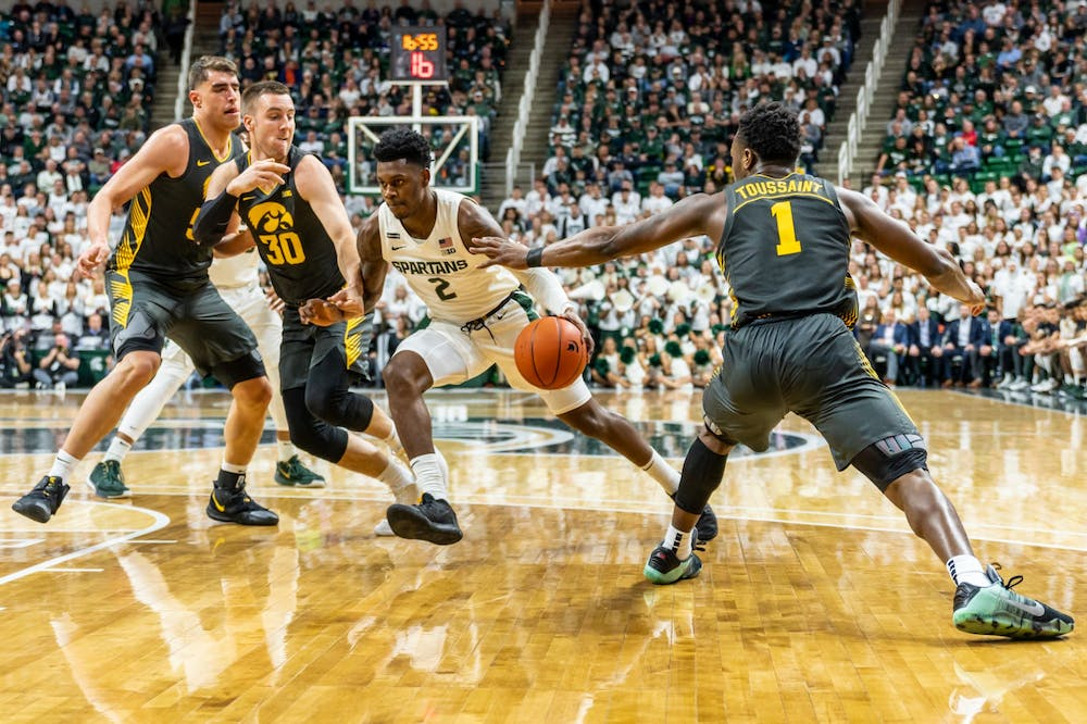 <p>Sophomore guard Rocket Watts (2) drives through Iowa defenders. The Spartans defeated the Hawkeyes, 78-70, at the Breslin Student Events Center on Feb. 25, 2020. </p>
