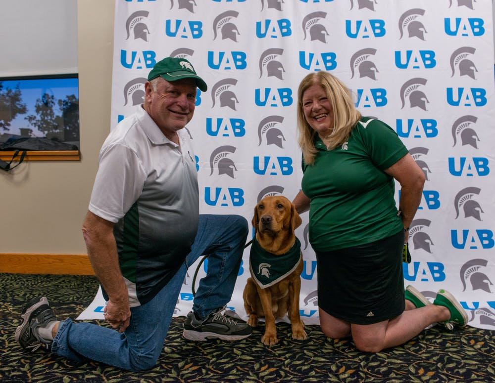 <p>Zeke&#x27;s handlers, Jim and Terri Foley, with the wonder dog at the UAB&#x27;s Zeke and Greet event on Wednesday, Sept. 29, 2021.</p>