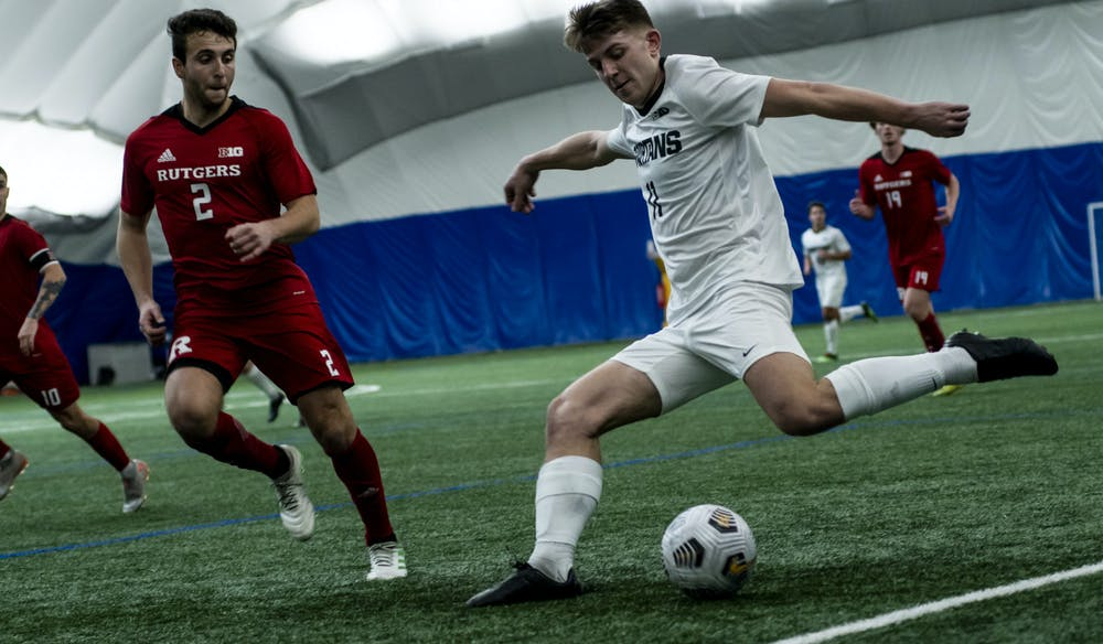 <p>Sophomore forward Gianni Ferri shoots the ball during the game against Rutgers on Feb. 19, at the St. Joe&#x27;s Sports Dome. The Spartans lost to the Scarlet Nights 0-2.</p>