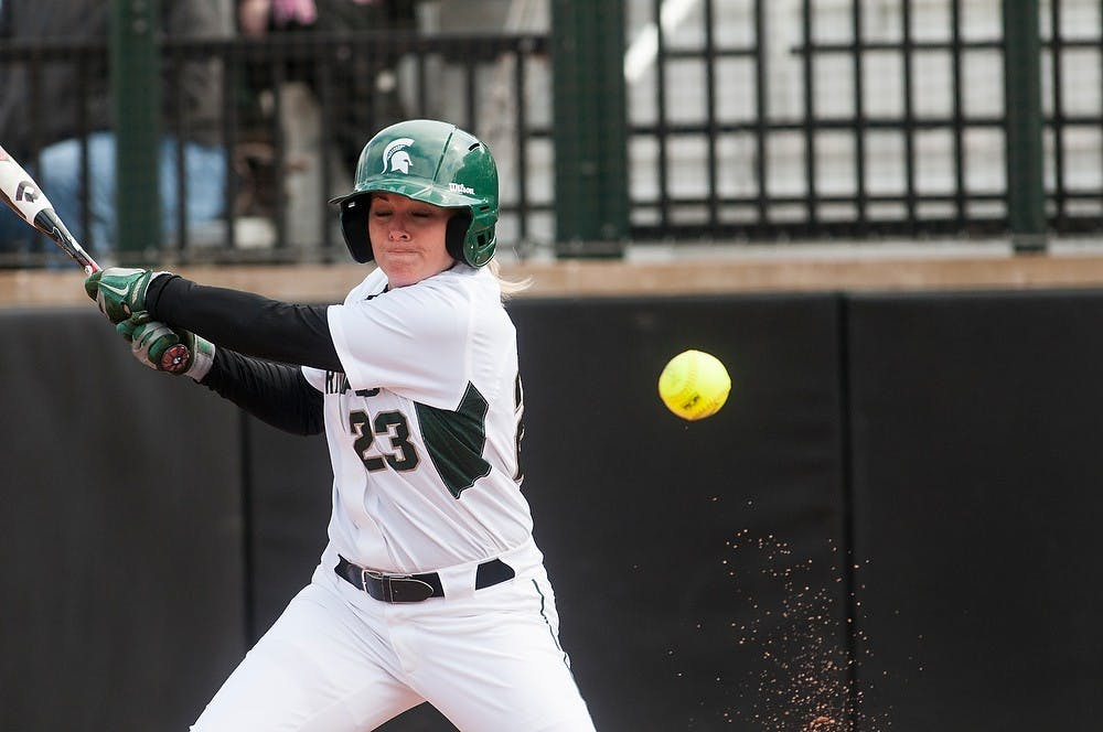 <p>Sophomore short stop and outfielder Alyssa McBride hits a ball into foul territory  during the game against Michigan, April 14, 2013, at Secchia Stadium at Old College Field. Katie Stiefel/The State News</p>