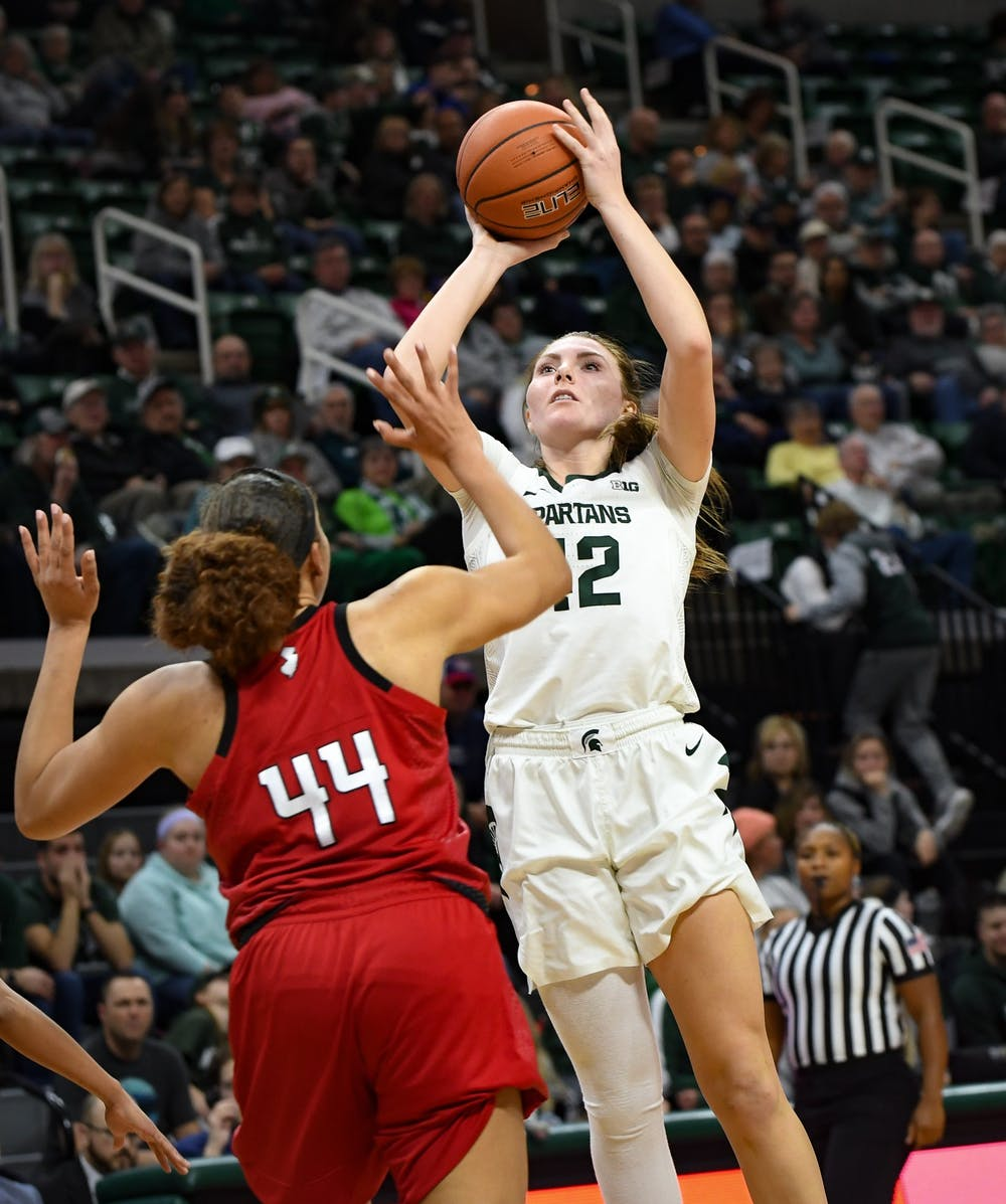 <p>Sophomore forward Kayla Belles (42) shoots over a defender during the women&#x27;s basketball game against Rutgers at the Breslin Center on Feb. 13, 2020. The Spartans ended a five game losing streak and defeated the Scarlet Knights, 57-53. </p>