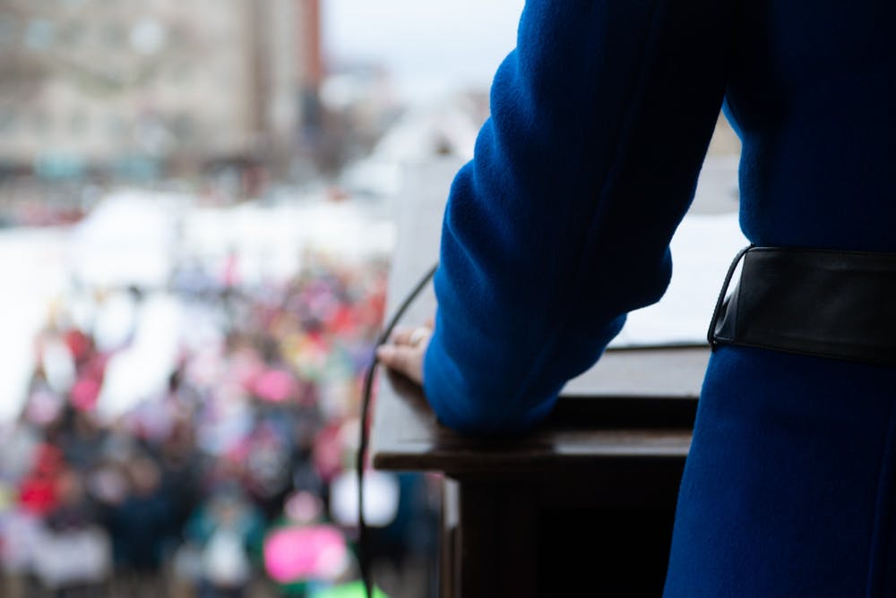 <p>Governor Gretchen Whitmer steps up to the podium to speak during the 2020 Lansing Women's March on Jan. 18.</p>