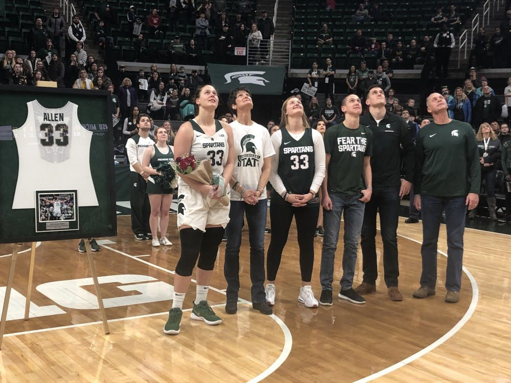 <p>Senior center Jenna Allen (33) is honored during senior night at the Breslin Center. The Spartans went on to defeat the Wolverines 74-64.&nbsp;</p>