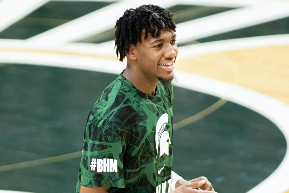 Junior forward Aaron Henry smiles before the Wolverines matchup with the Spartans on Mar. 6, 2021.