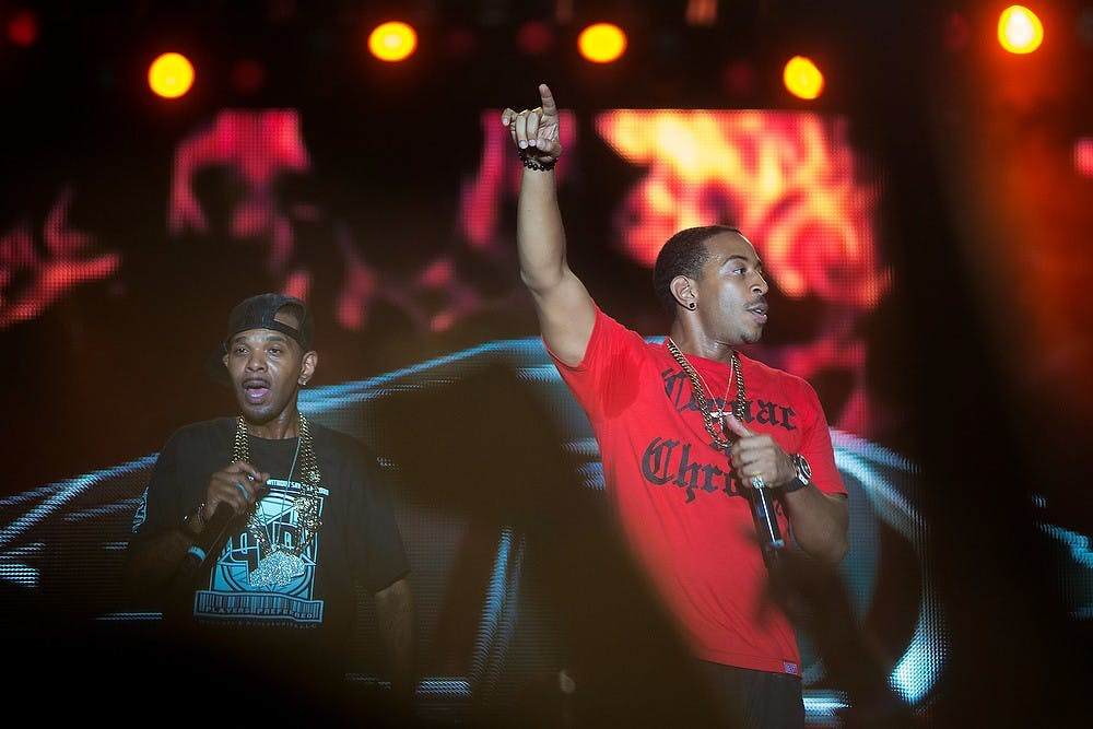 <p>Rapper Ludacris, right, performs on stage with Lil&#8217; Fate, July 14, 2013, at Adado Riverfront Park in Lansing during Common Ground Music Festival. This was the last day of the seven-day music event. Justin Wan/The State News</p>