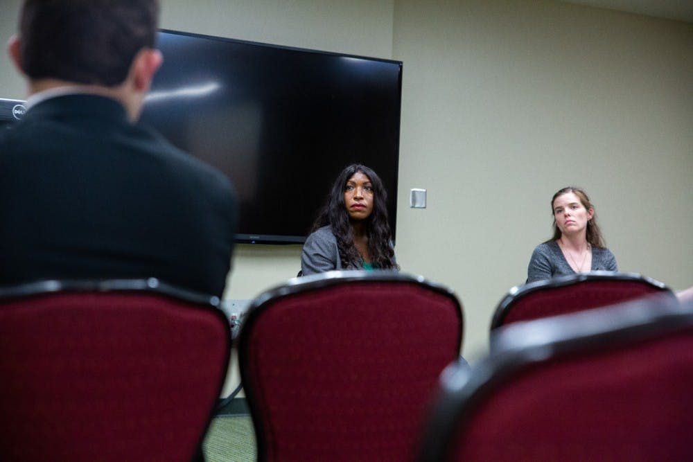 Trustees Brianna T. Scott and Kelly Tebay listen during a campus town hall meeting on Sept. 23, 2019 in the MSU Union.