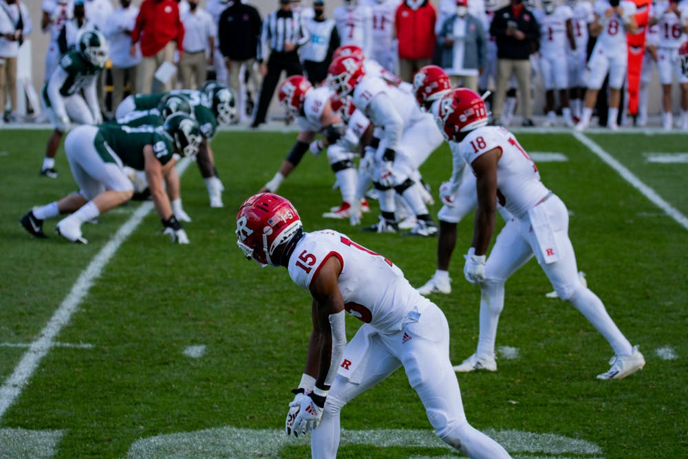 Max Melton, 15, and his team prepare for a play during a game against MSU in Spartan Stadium on Oct. 24, 2020.