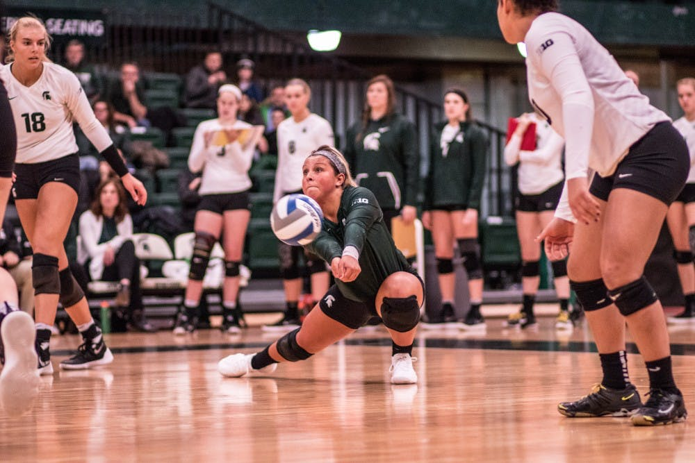 Freshman libero Jayme Cox (4) passes a ball during the game against Indiana on November 18, 2017, at Jenison Fieldhouse. The Spartans defeated the Hoosiers, 3-0.