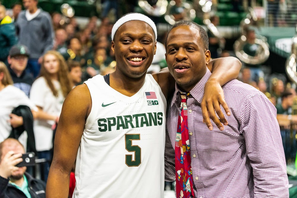 Senior guard Cassius Winston (left) and his brother, Zachary Winston, pose for photos following MSU's win over Albion College. The Spartans defeated the Britons, 85-50, at half at the Breslin Student Events Center on October 29, 2019.