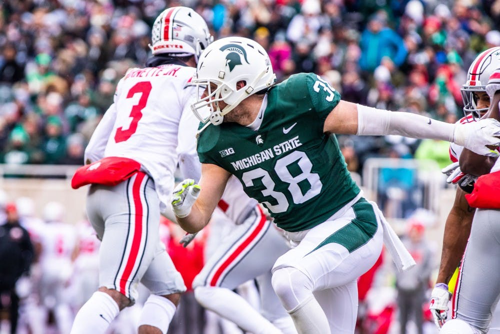 <p>Redshirt senior linebacker Byron Bullough (38) runs upfield on special teams during the game against Ohio State on Nov. 10, 2018.</p>