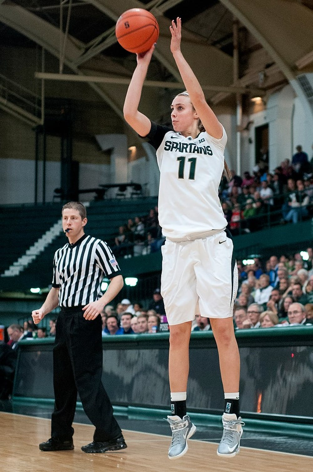 """<p>Junior forward Annalise Pickrel attempts a 3-point field goal. She contributed 15 points for <span class=""""caps"""">MSU</span> as the Spartans defeated <span class=""""caps"""">IPFW</span>, 64-36, Sunday, Dec. 16, 2012, at Jenison Field House. Justin Wan/The State News</p>"""