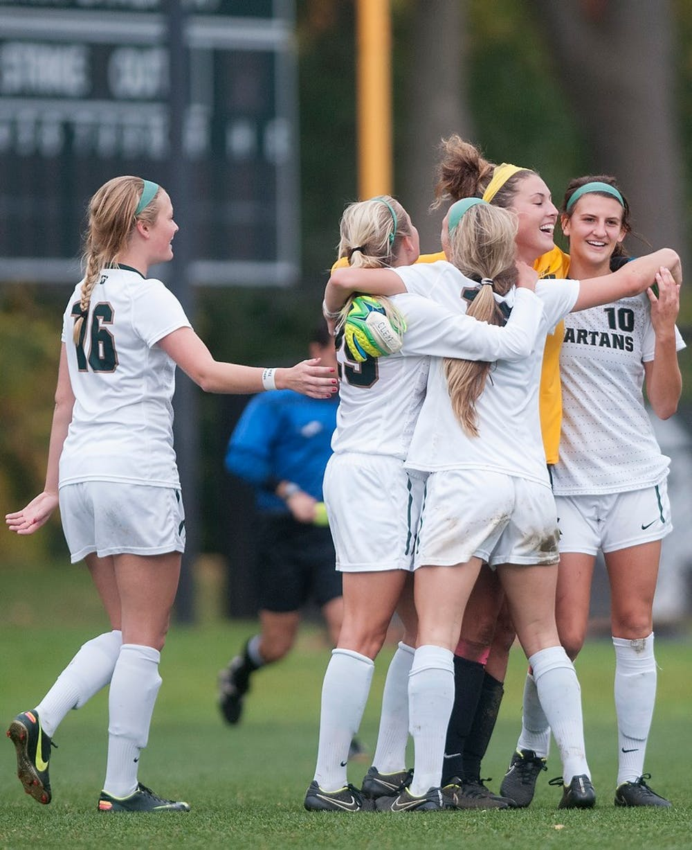 <p>The Spartans celebrate after a win against Ohio State on Oct. 16, 2014, at the DeMartin Soccer Stadium at Old College Field. The Spartans defeated the Buckeyes, 2-1. Jessalyn Tamez/The State News </p>