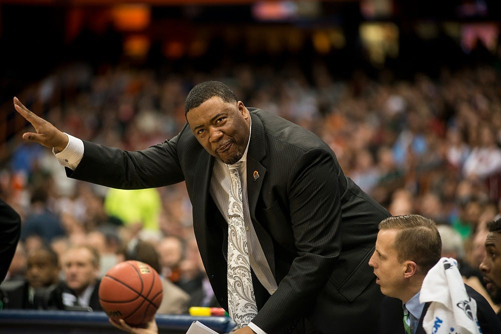 <p>Assistant Head Coach Dwayne Stephens gestures to his players on March 27, 2015, during the East Regional round of the NCAA Tournament at the Carrier Dome in Syracuse, New York. The Spartans beat the Sooners, 62-58. Erin Hampton/The State News</p>