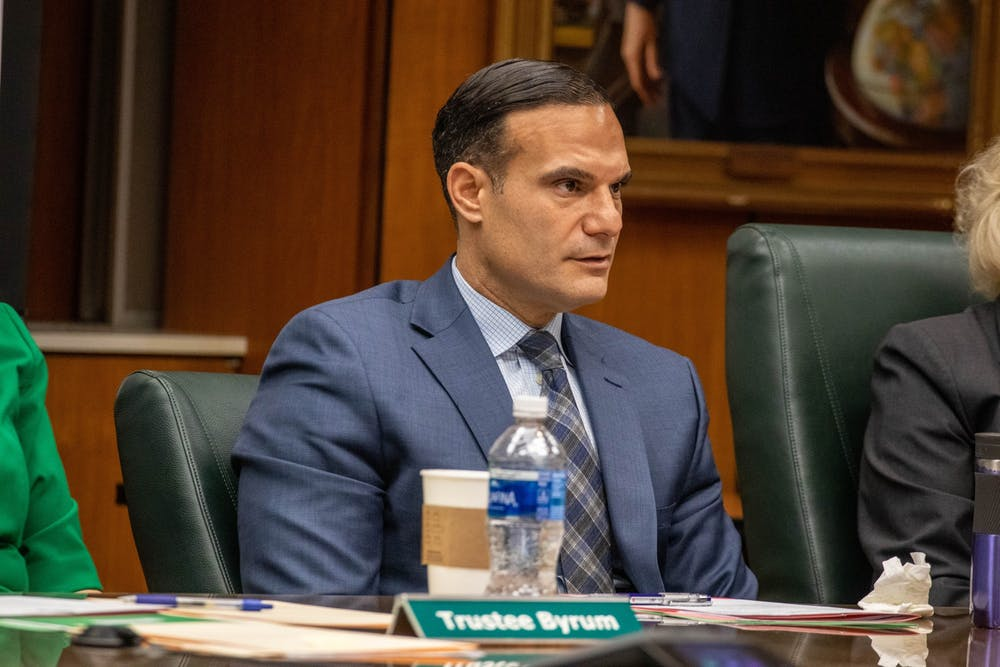 <p>Trustee Brian Mosallam listens at the Board of Trustees meeting on Dec. 13, 2019.</p>