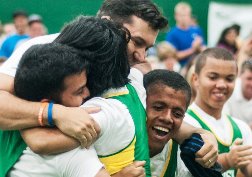 <p>The Brazilian weight lifters celebrate with one of the coaches after a successful lift by one of the team members at the 2013 World Dwarf Games, August 9, 2013, in the Tennis Courts of IM West. Brazil brought four competitors to the competition. Danyelle Morrow/The State News</p>