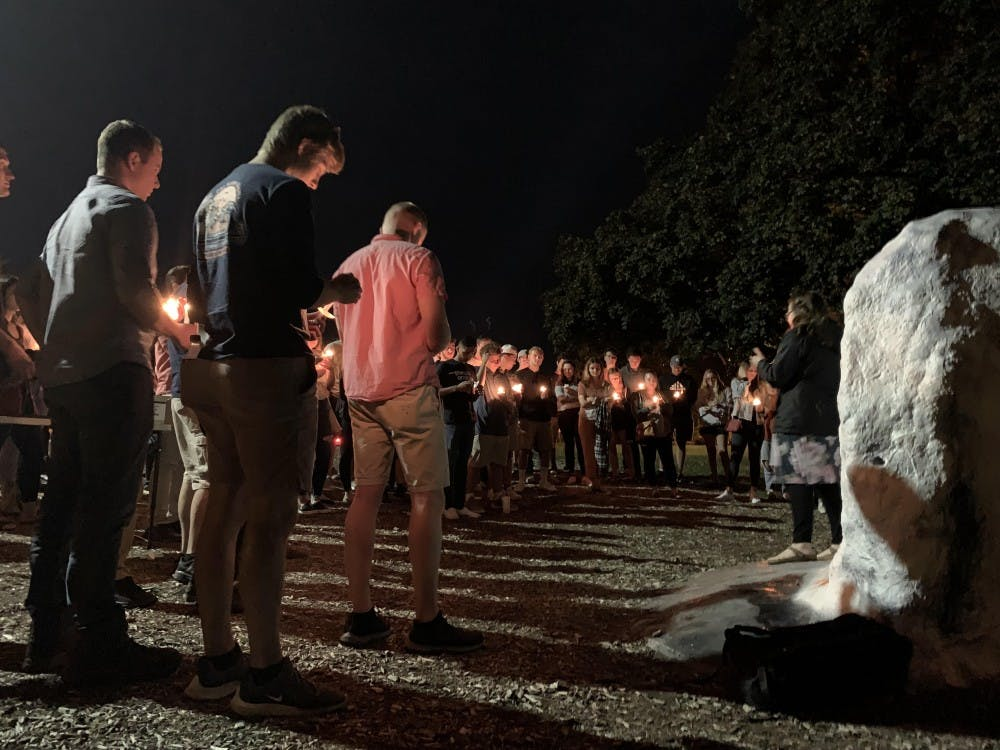 <p>Students attend a candlelight vigil for 2018 MSU graduate Jeremy Swiatek on Wednesday, Sept. 18.</p>