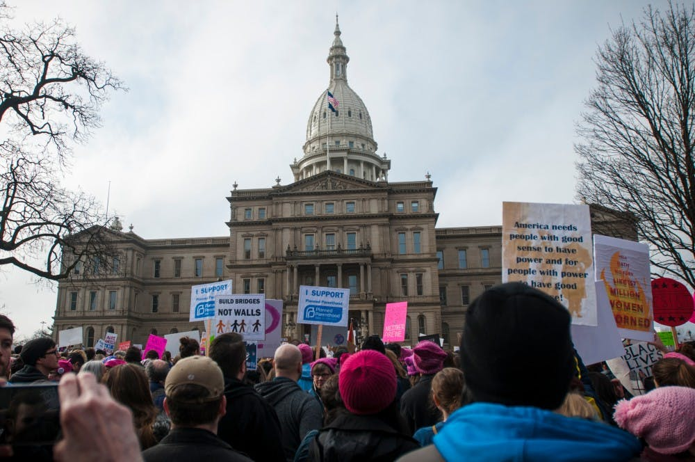 on Jan. 21, 2017 at the Capital Building in Lansing. Activists gathered and expressed their opinions.