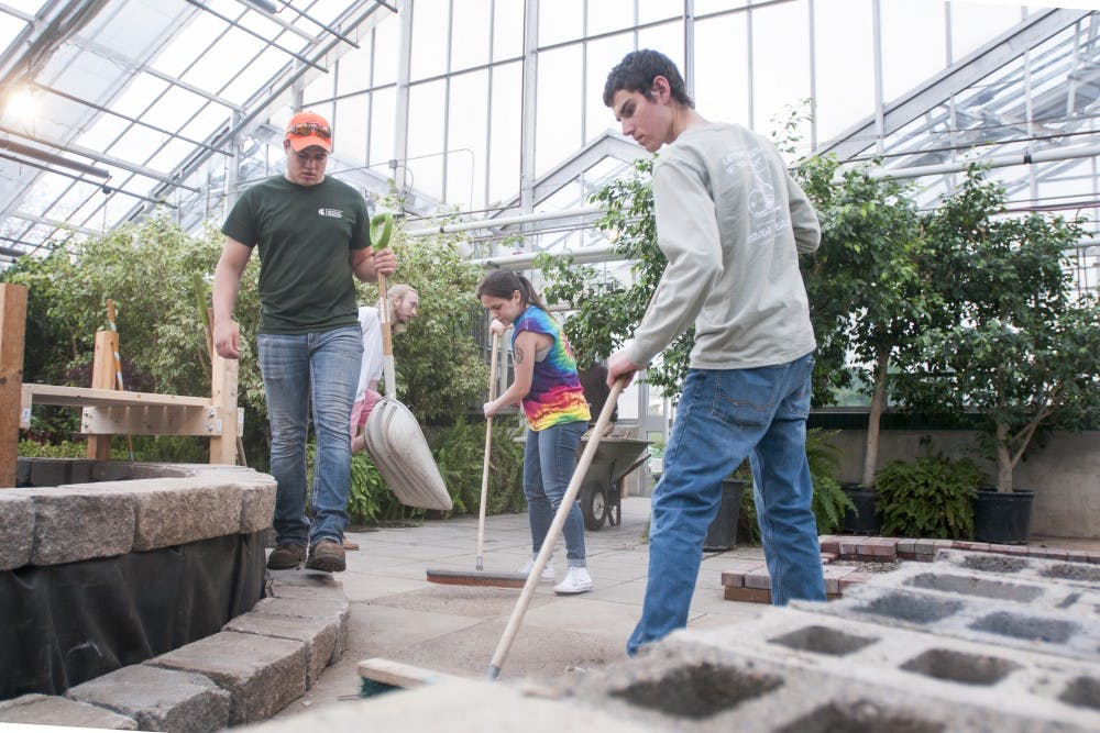 <p>Members of the MSU Student Horticulture Association prepare for the annual Spring Show Plant Sale on April 19, 2017 at the Plant and Soil Sciences Building. Their annual Spring Show Plant Sale is taking place on April 22-23.&nbsp;</p>