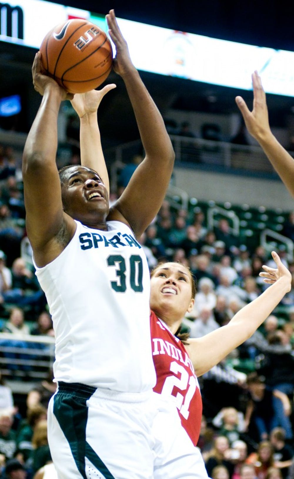 Red shirt senior Lykendra Johnson goes up for a lay up against forward Danilsa Andujar Thursday night at Breslin Center. The spartans pulled away in the second half coming up with a 67-47 victory over the Indiana Hoosiers. Aaron Snyder/The State News.