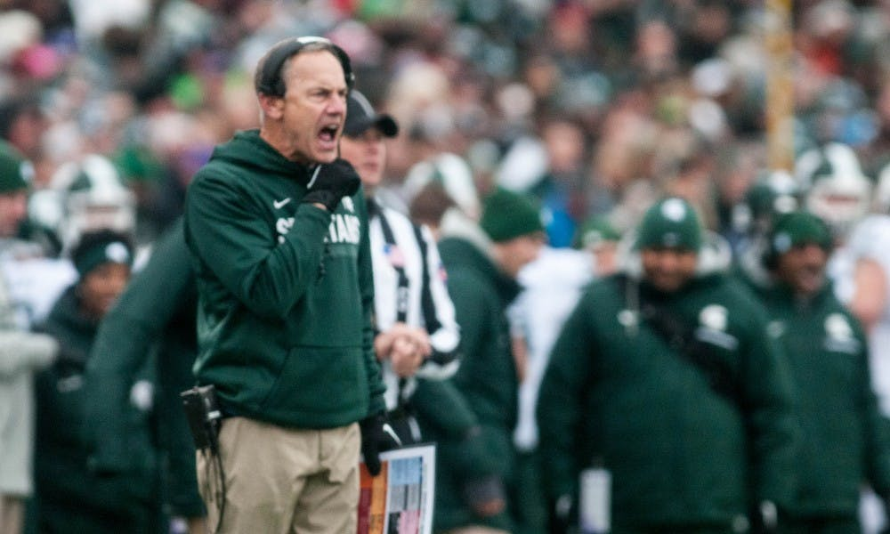 <p>Head coach Mark Dantonio yells during the game against Northwestern on Oct. 28, 2017 at Ryan Field. The Spartans fell to the Wildcats, 39-31, in triple overtime.</p>