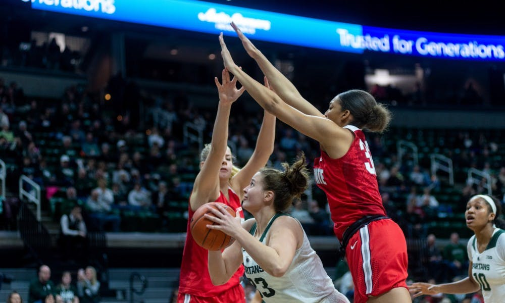 Senior center Jenna Allen shoots a layup against Ohio State. The Spartans lost to the Buckeyes, 70-77, on Feb. 21, 2019 at the Breslin Center.