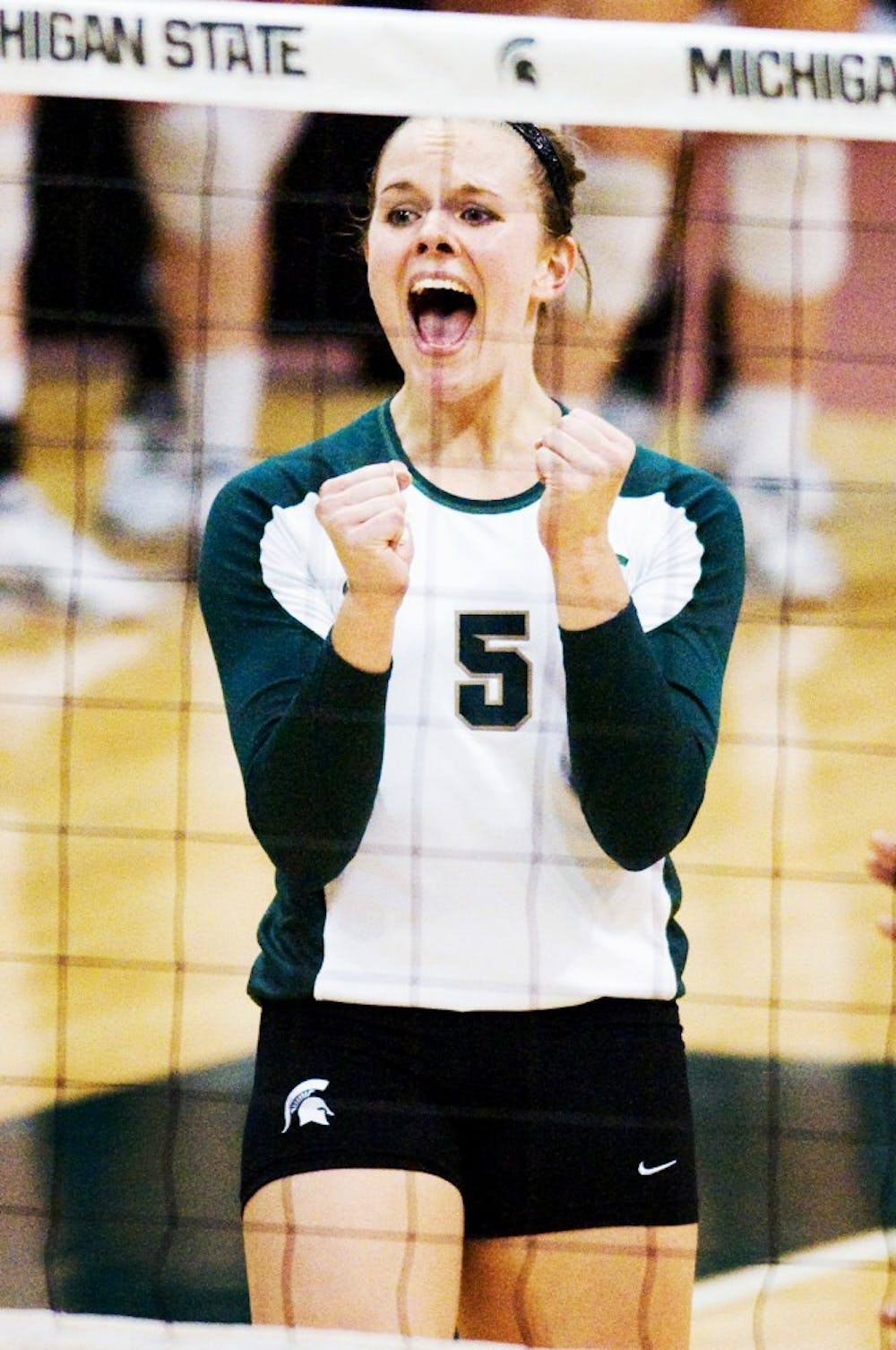 Senior outside hitter Jenilee Rathje reacts to play Wednesday at Jenison Field House. The Spartans defeated the Michigan Wolverines 3-1. Matt Radick/The State News