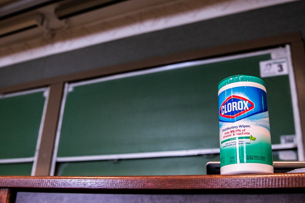 <p>A tub of disinfectant wipes are pictured in an empty Kedzie Hall classroom after MSU canceled classes due to coronavirus March 11, 2020.</p>