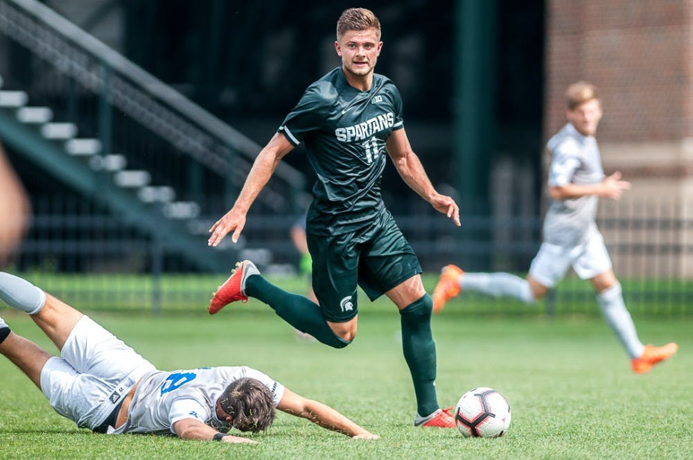Senior forward Ryan Sierakowski (11) looks for a pass during the game against Tulsa on August 26, 2018 at DeMartin Stadium. The game ended in a draw between the Spartans and Golden Hurricanes.