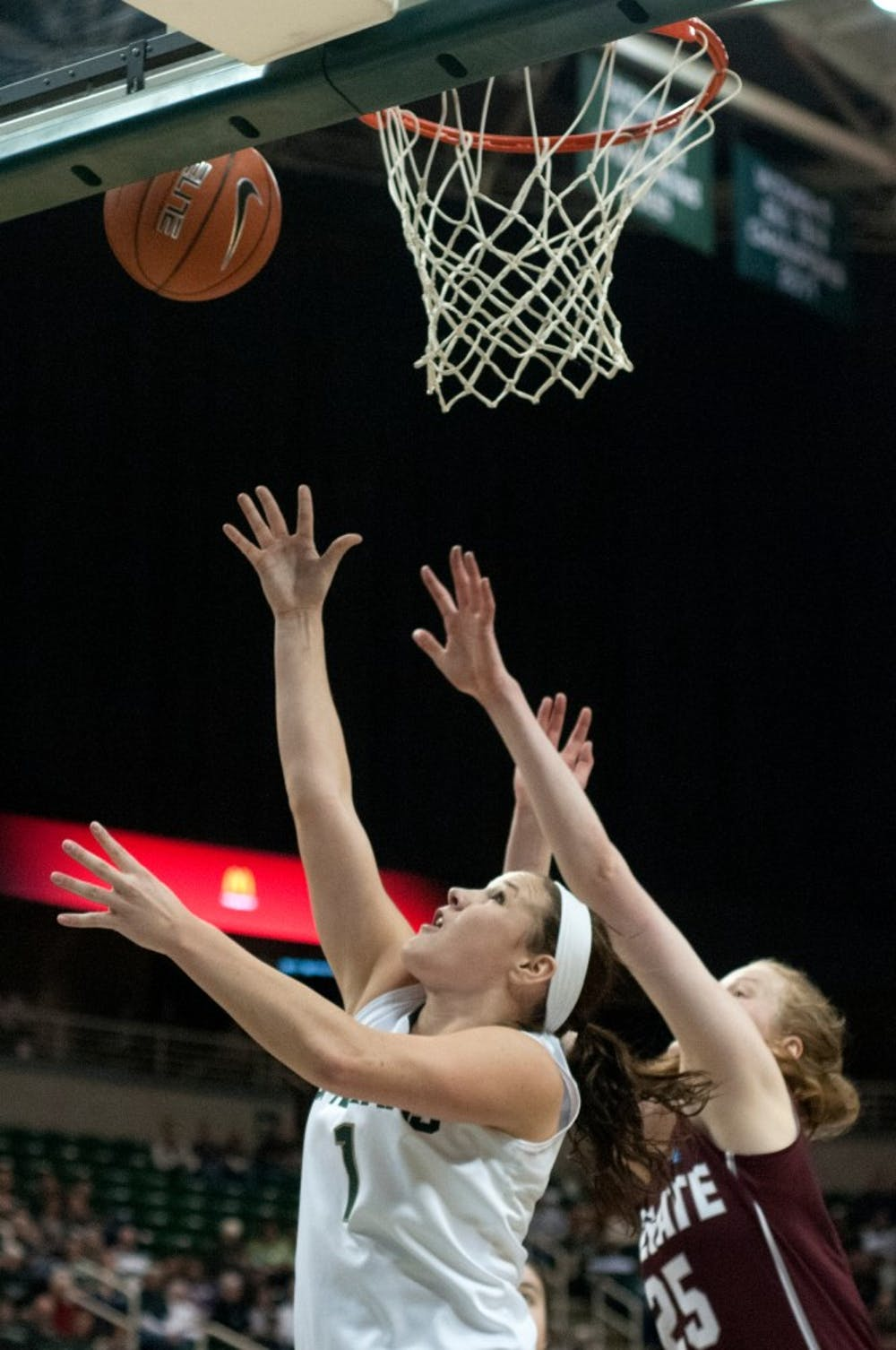 <p>Freshman guard Tori Jankoska goes up for the basket as Colgate forward Josie Stockill defends Dec. 29, 2013, at Breslin Center. The Spartans won, 96-46. Julia Nagy/The State News</p>