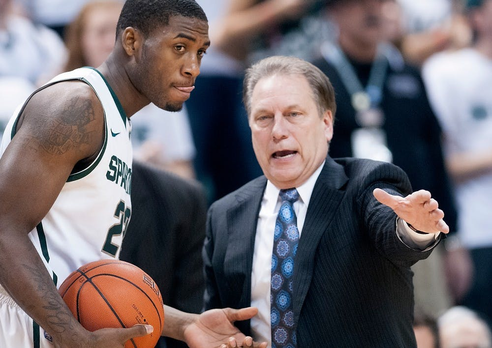 <p>Head coach Tom Izzo talks with sophomore guard Branden Dawson in the second half of the game. The Spartans defeated the Fighting Illini,, 80-75, Thursday, Jan. 31, 2013, at Breslin Center. Justin Wan/The State News</p>