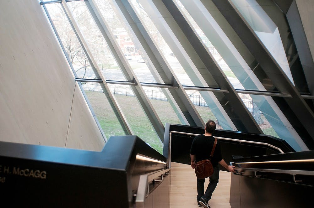 "<p>New York resident and ""Metropolis"" magazine reporter Robert Landon walks from the third floor of the Eli and Edythe Broad Art Museum on Nov. 9, 2012, at the opening for the media.</p>"