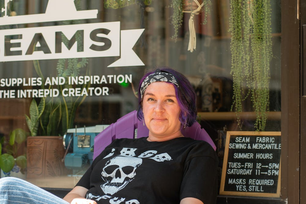 <p>New East Lansing Mayor Jessy Gregg in front of her store Seams Fabric on August 22nd, 2021.</p>