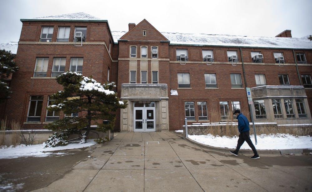 <p>A student walks into Olin Health Center on Feb. 27, 2020.</p>