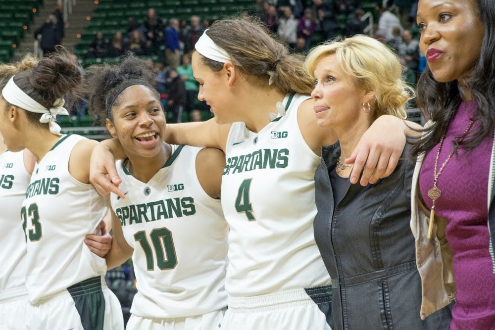 Sophomore guard Branndais Agee, 10, reacts to a comment by graduate student center Jasmine Hines, 4, on Jan. 10, 2016 during the game against Northwestern at Breslin Center. The Spartans defeated the Wildcats, 74-51.