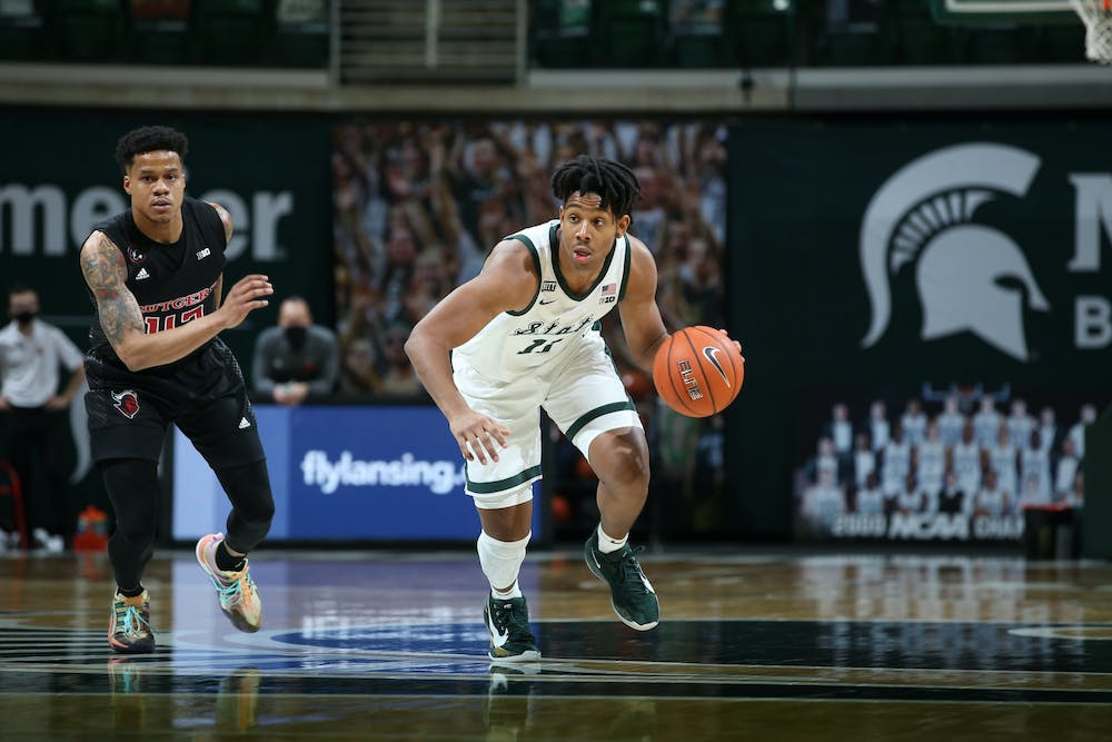 MSU guard A.J. drives in transition against Rutgers on Jan. 5, 2021 at the Breslin Center. The freshman guard started his second straight game at point guard, both culminating in wins for Michigan State.