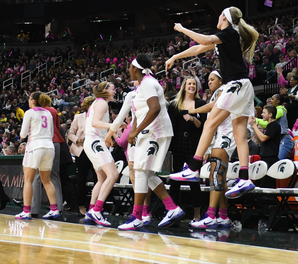 The Spartan bench celebrates a comeback during the women's basketball game against Michigan at the Breslin Center on February 23, 2020. The Spartans fell to the Wolverines 65-57.