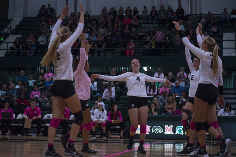 The Spartans celebrate after scoring a point during the game against Rutgers on Oct. 19, 2016 at Jenison Fieldhouse The Spartans defeated the Scarlet Knights, 2-1.