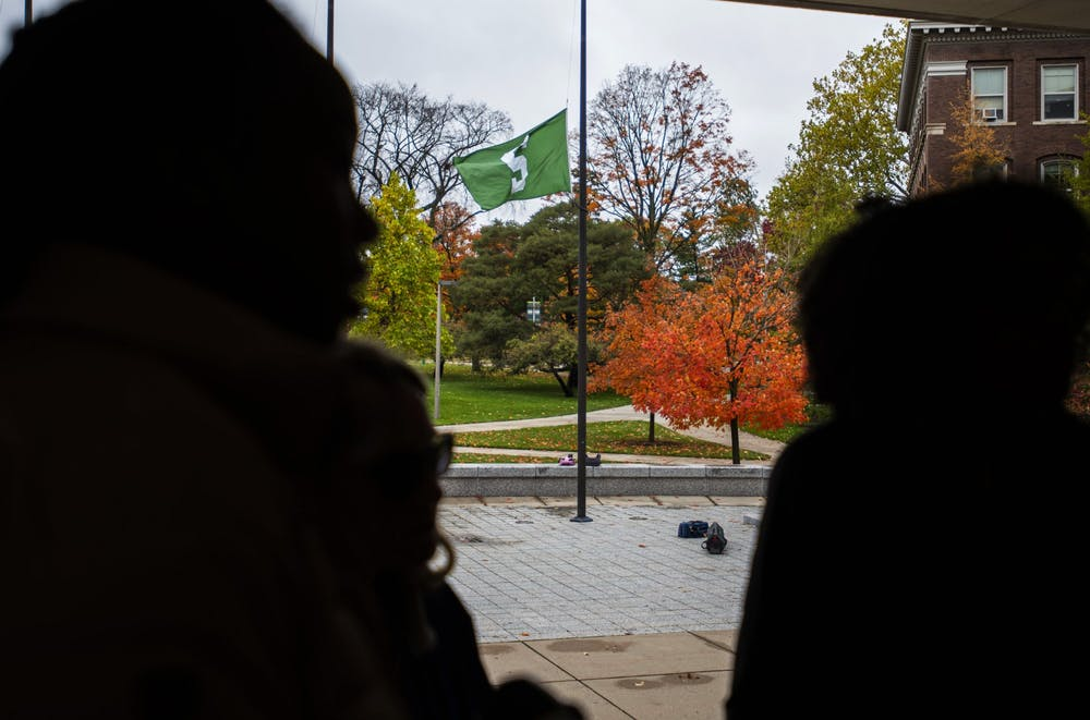 <p>A Spartan flag is flown out front of the Hannah Administration Building on Dec. 8th, 2019. </p>