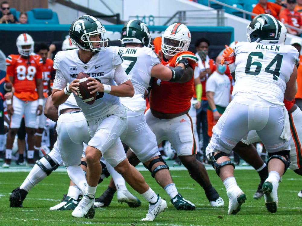 <p>Redshirt sophomore quarterback Payton Thorne (10) looks for an opening in defense during the first quarter of their game against Miami on Sept. 18, 2021. </p>