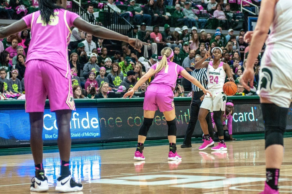 Freshman guard Nia Clouden (24) signals during the women's basketball game against Purdue at Breslin Center on Feb. 3, 2019. The Spartans defeated the Boilmakers 74-66.