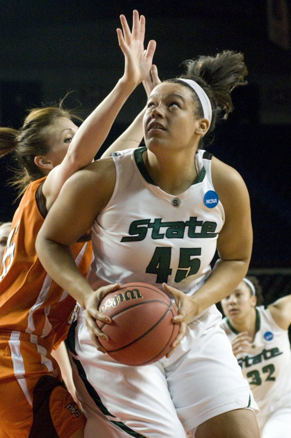 Senior center Lauren Aitch looks up toward the basket over Bowling Green center Chelsea Albert before shooting Saturday in MSU's first-round NCAA Tournament game in Louisville, Ky. Aitch had 10 points in MSU's 72-62 victory over Bowling Green.