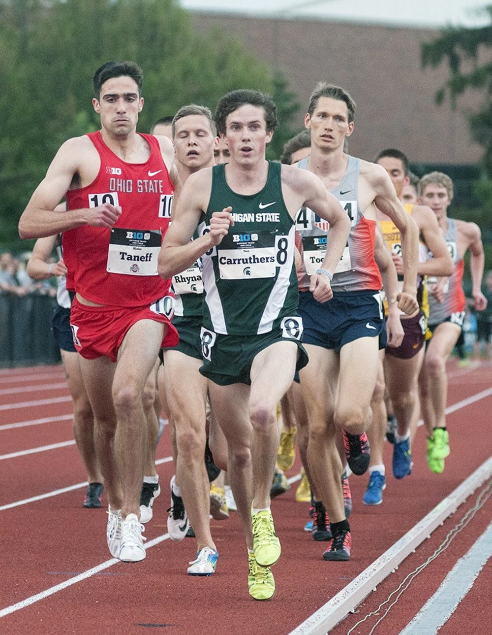 <p>Senior Ben Carruthers leads the pack early in the 10,000 meter race during the Big Ten Conference Track and Field Championships May 15th, 2015 at Ralph Young Field. Ryan Squanda/The State News</p>