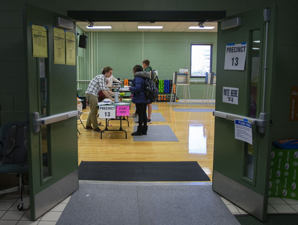 <p>Volunteers help students during their voting process at the District 13 polling precinct in IM East. The Michigan primary took place on March 10, 2020.</p>