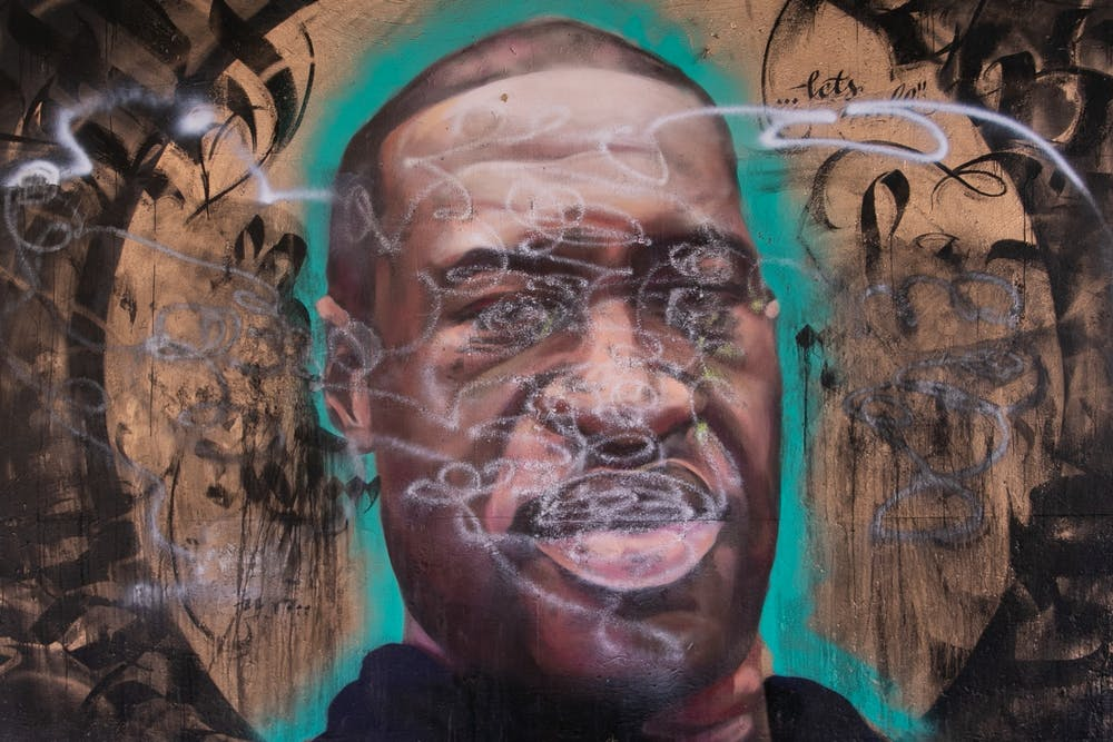 <p>A mural of George Floyd painted after his death at the hands of Minneapolis police that was later defaced is pictured on Lansing River Trail on July 8, 2020.</p>