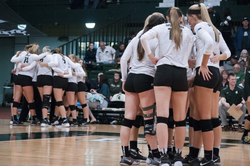 The Spartans huddle up for a timeout during the game against Arizona on Dec. 3, 2016 at Jenison Field House. The Spartans were defeated by the Wildcats, 3-2.