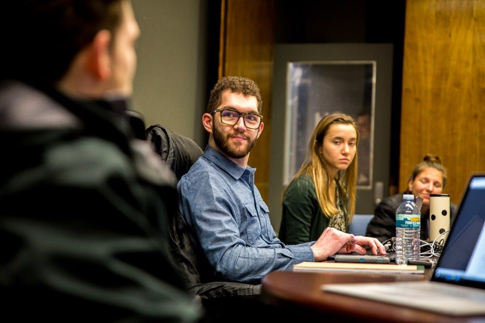 Social relations and policy senior Colin Wiebrecht listens to a committee member speak during an ASMSU meeting on Jan. 24, 2019, at the Student Services Building.