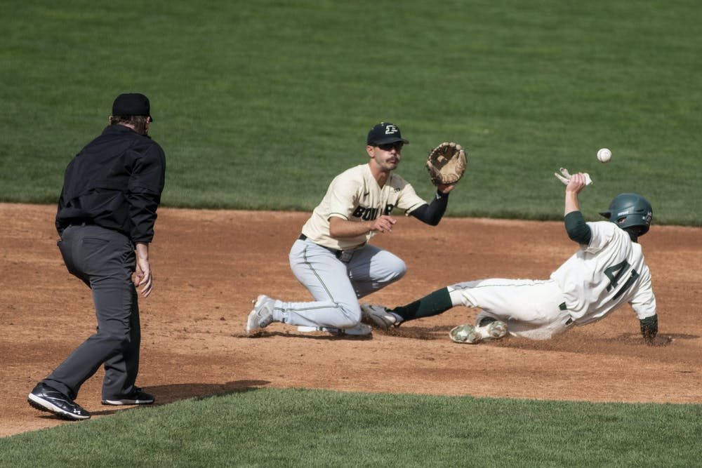 <p>Freshman infielder Mitch Jebb (41) slides into second base as the ball comes his way during the game against Purdue on April 11, 2021, at McLane Stadium. The Spartans defeated the Boilermakers, 5-2.</p>