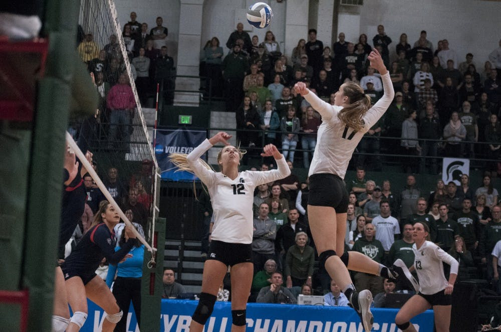 Junior middle blocker Alyssa Garvelink (17) prepares to spike the ball during the game against Arizona on Dec. 3, 2016 at Jenison Field House.  The Spartans were defeated by the Wildcats, 3-2.