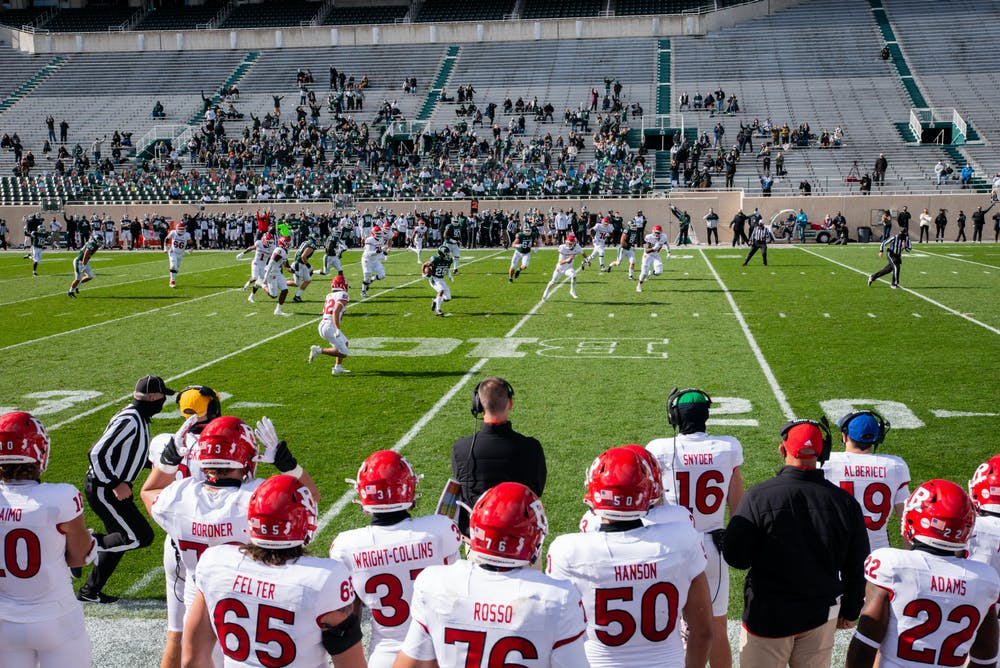 <p>MSU catches an interception in the first half of a game against Rutgers at Spartan Stadium on Oct. 24, 2020.</p>