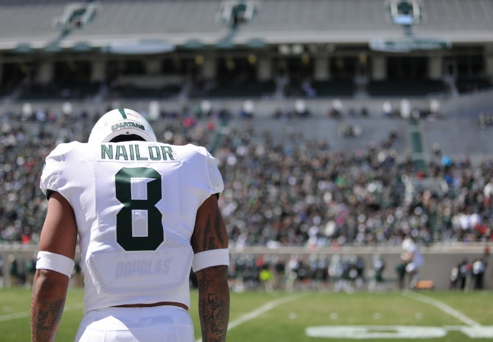<p>Wide receiver Jalen Nailor (8) walks on to the field during the Green and White game on April 13, 2019 at Spartan Stadium. The green team defeated the white team, 42-26.</p>